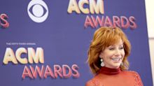 Reba McEntire rewears iconic red dress from 1993 -- and looks stunning