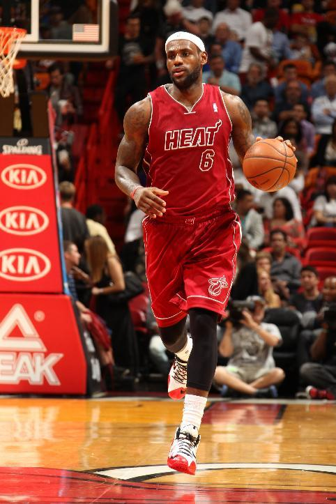 lebron james misses heat practice with ankle pain