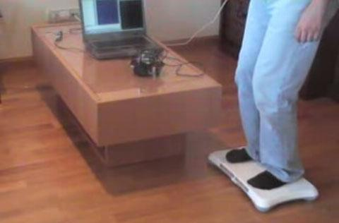 Man uses Wii Balance Board to control robot, takes aim at Segway next