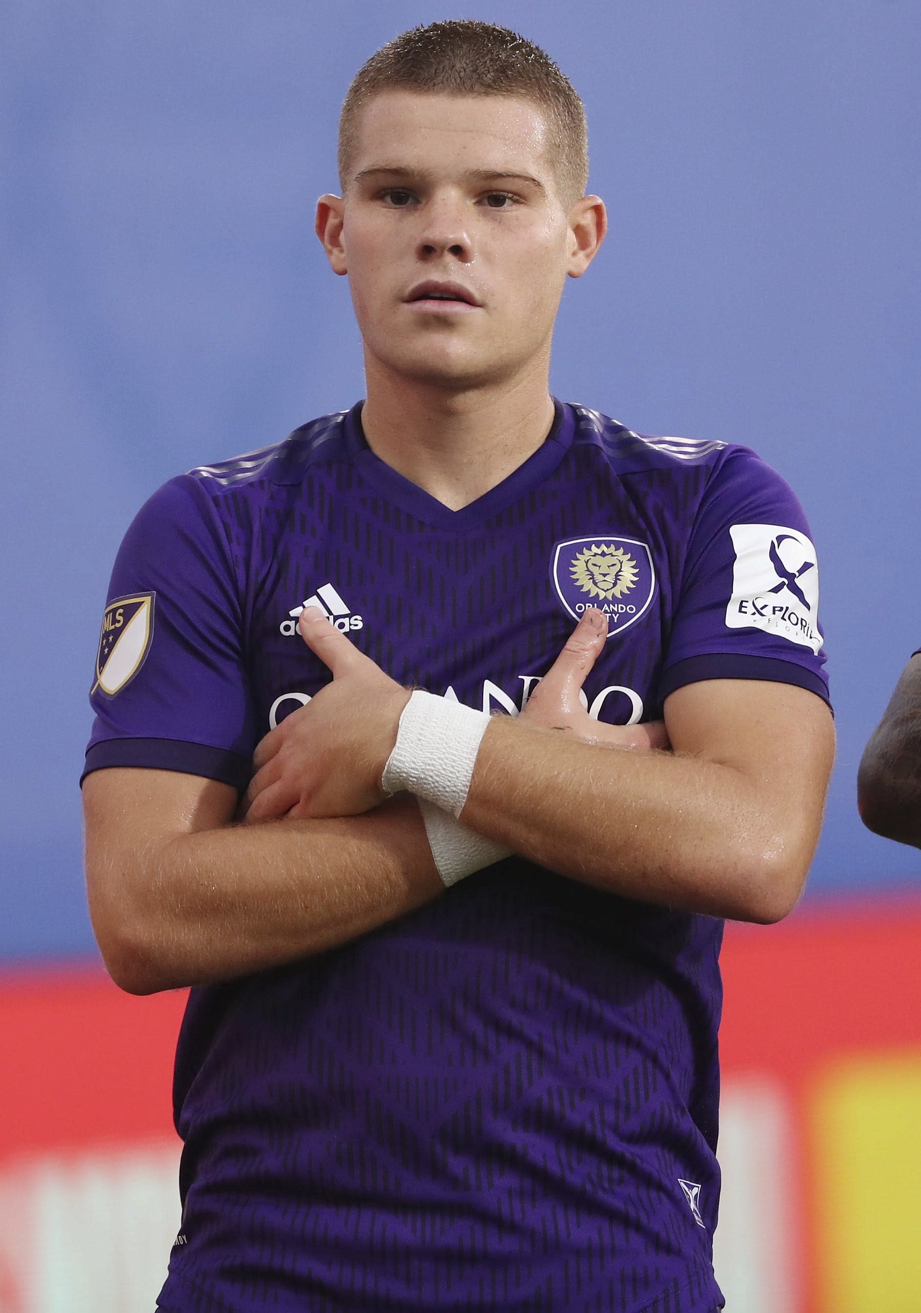 Orlando City's Chris Mueller stares at photographers with folded arms to celebrate after scoring a goal against New York City FC during an MLS is Back tournament soccer match, Tuesday, July 14, 2020, in Lake Buena Vista, Fla. (Stephen M. Dowell/Orlando Sentinel via AP)