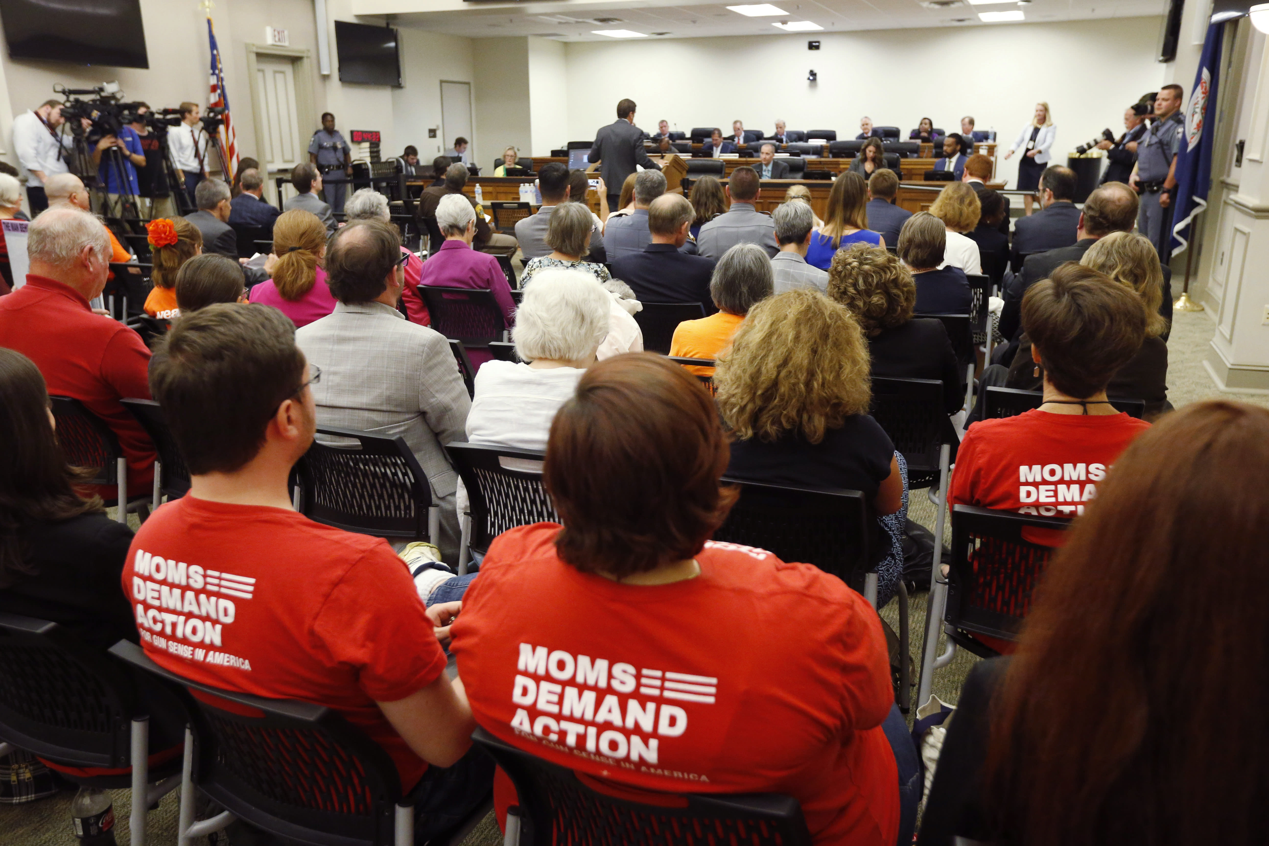 Attendees wear shirts during the second day of a Virginia Crime Commission meeting on gun issues at the Capitol in Richmond, Va., Tuesday, Aug. 20, 2019. Democratic Gov. Ralph Northam called the special session after a city employee opened fire in a Virginia Beach municipal complex May 31. (AP Photo/Steve Helber)