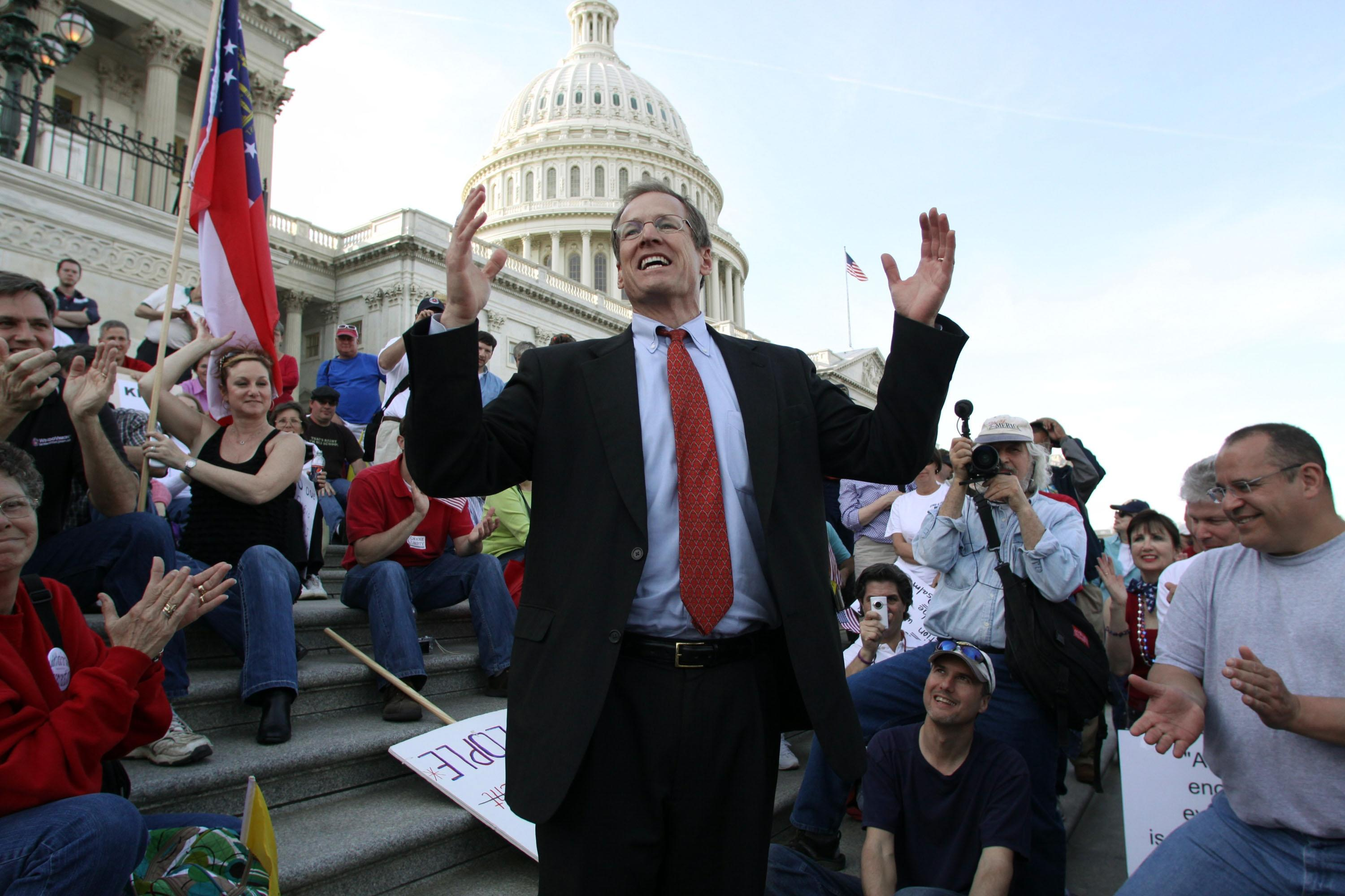 FILE - In this March 20, 2010 file photo, Rep. Jack Kingston, R-Ga., speaks to people demonstrating against the health care bill on the U.S. Capitol steps a day before Congress is set to vote on health care reform on Capitol Hill in Washington. Republicans see the 2014 midterm elections as a chance to capitalize on voter frustration with the problem-plagued health care overhaul, but the GOP first must settle a slate of Senate primaries where conservatives are arguing over the best way to oppose President Barack Obama's signature law. Kingston, who wants to succeed retiring GOP Sen. Saxby Chambliss, stepped into the rift recently when he seemed to scold much of his party during an interview on a conservative talk radio show.(AP Photo/Lauren Victoria Burke)