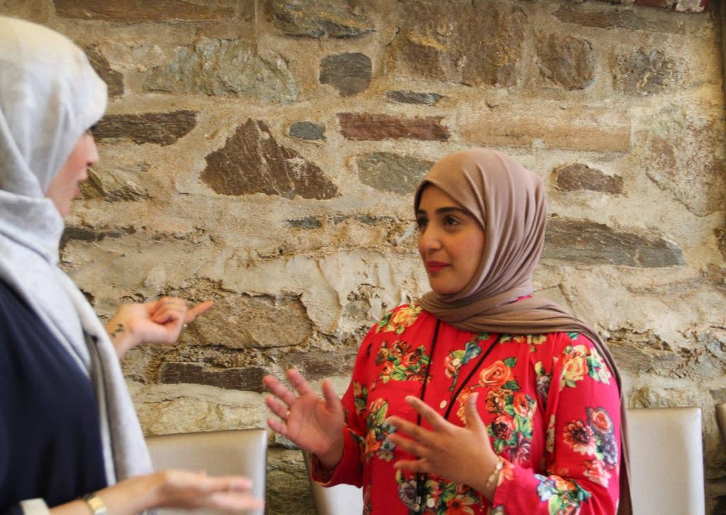 Saudi entrepreneurs Asmaa Alabdallah (L), founder of BitGo, and Reem Dad (R), co-founder of Taibah VR, talk at Halcyon in Washington (AFP Photo/Olivia Hampton)