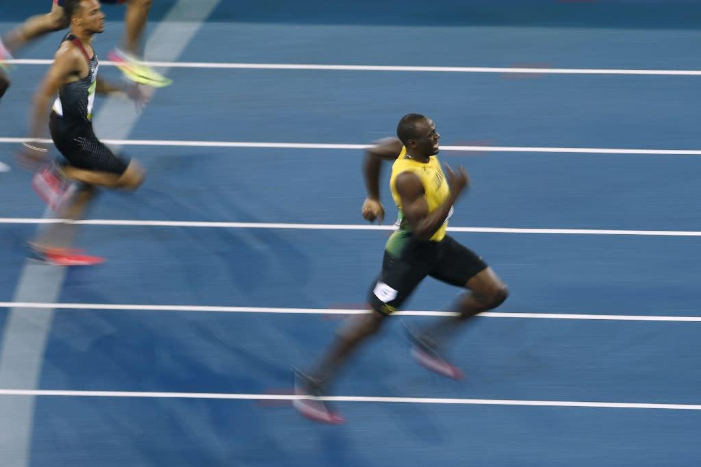 Jamaica's Usain Bolt wins third Olympic 200m title