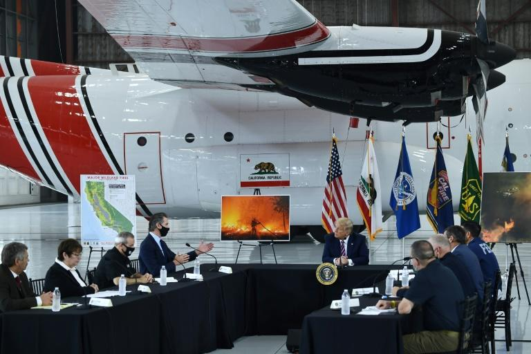 Trump predicts climate to cool down in wildfires briefing
