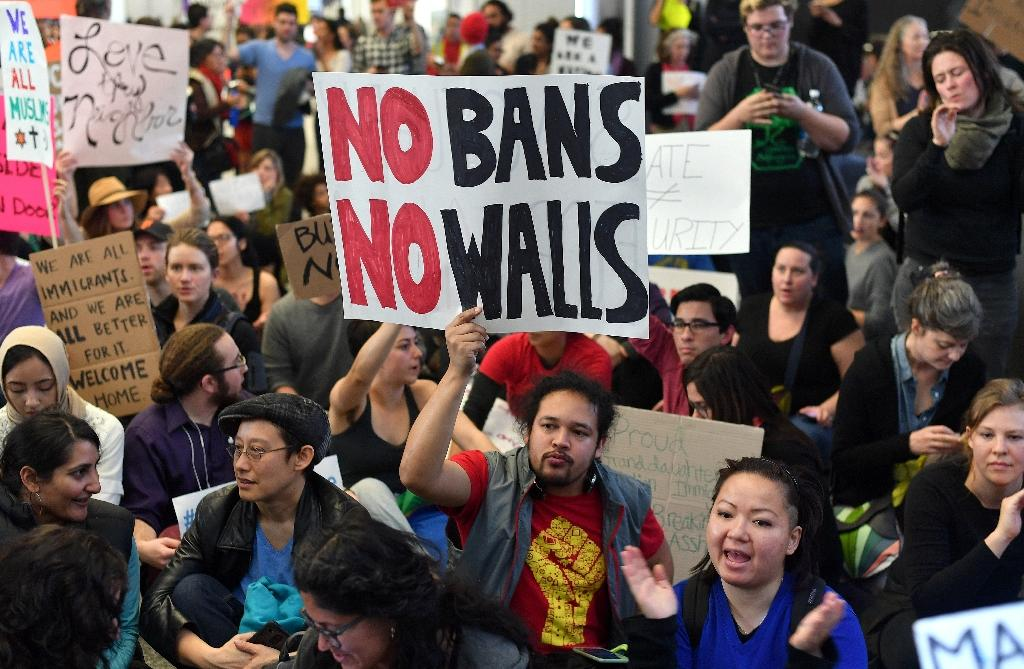 Protesters demonstrate at San Francisco International Airport in California, in January 2017 (AFP Photo/Josh Edelson)