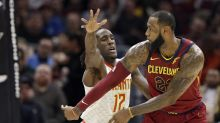 LeBron James dishes behind-the-back pass to help him tie career-high
