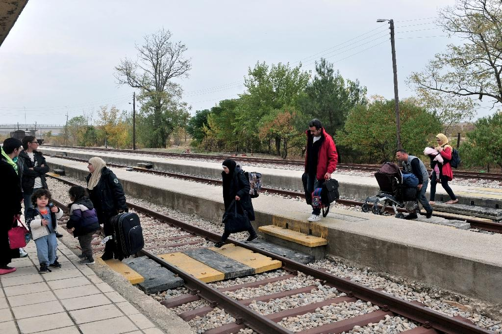 Adan's family members cross the railway as they arrive at the train station of Didymoteicho 400 km from the Greek-Turkish border, as they attempt to make the long journey home to Aleppo, Syria (AFP Photo/Sakis Mitrolidis)