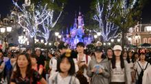 From temples to Disneyland, China shuts down to halt virus