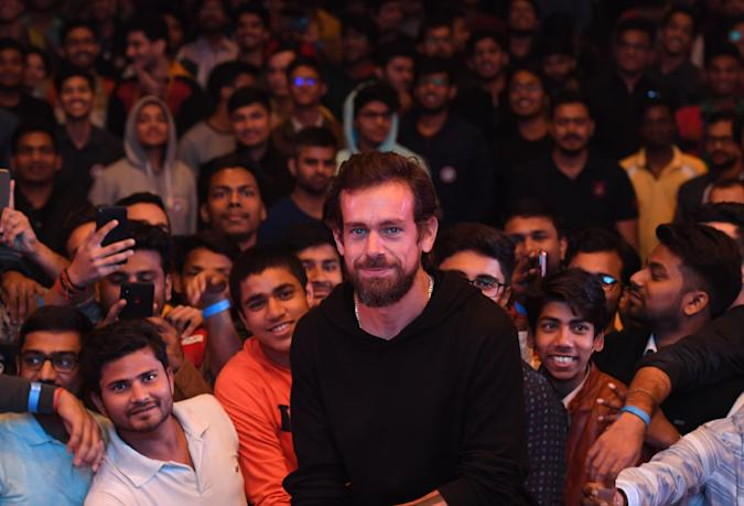 Twitter CEO and co-founder Jack Dorsey (C) poses with students after an interaction session at the Indian Institute of Technology (IIT) in New Delhi on November 12, 2018. - Dorsey hosted a town hall meeting with university students on his visit to the Indian capital New Delhi. (Photo by Prakash SINGH / AFP)        (Photo credit should read PRAKASH SINGH/AFP via Getty Images)