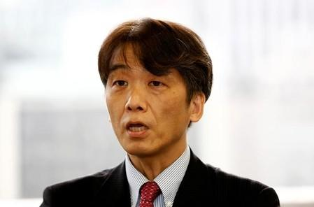 FILE PHOTO: Hiromi Yamaoka, head of Bank of Japan's (BOJ) payment and settlement system division, speaks at an interview with Reuters at his office in Tokyo