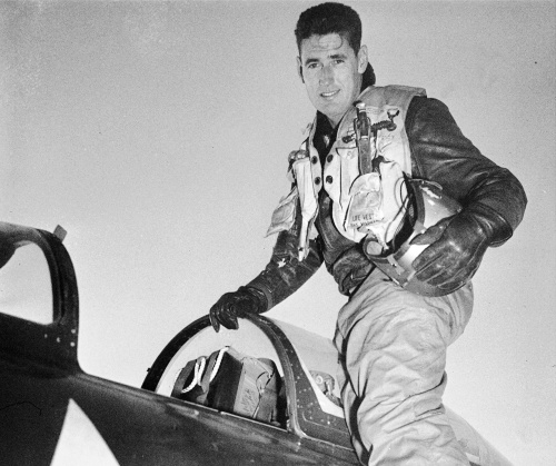 In this 1953 file photo, Capt. Ted Williams poses atop an airplane at a Marine air base in Korea after he crash landed his thunder jet at an advance airbase. (AP)