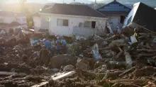 Japan flood toll nears 200, sun scorches thousands battling thirst