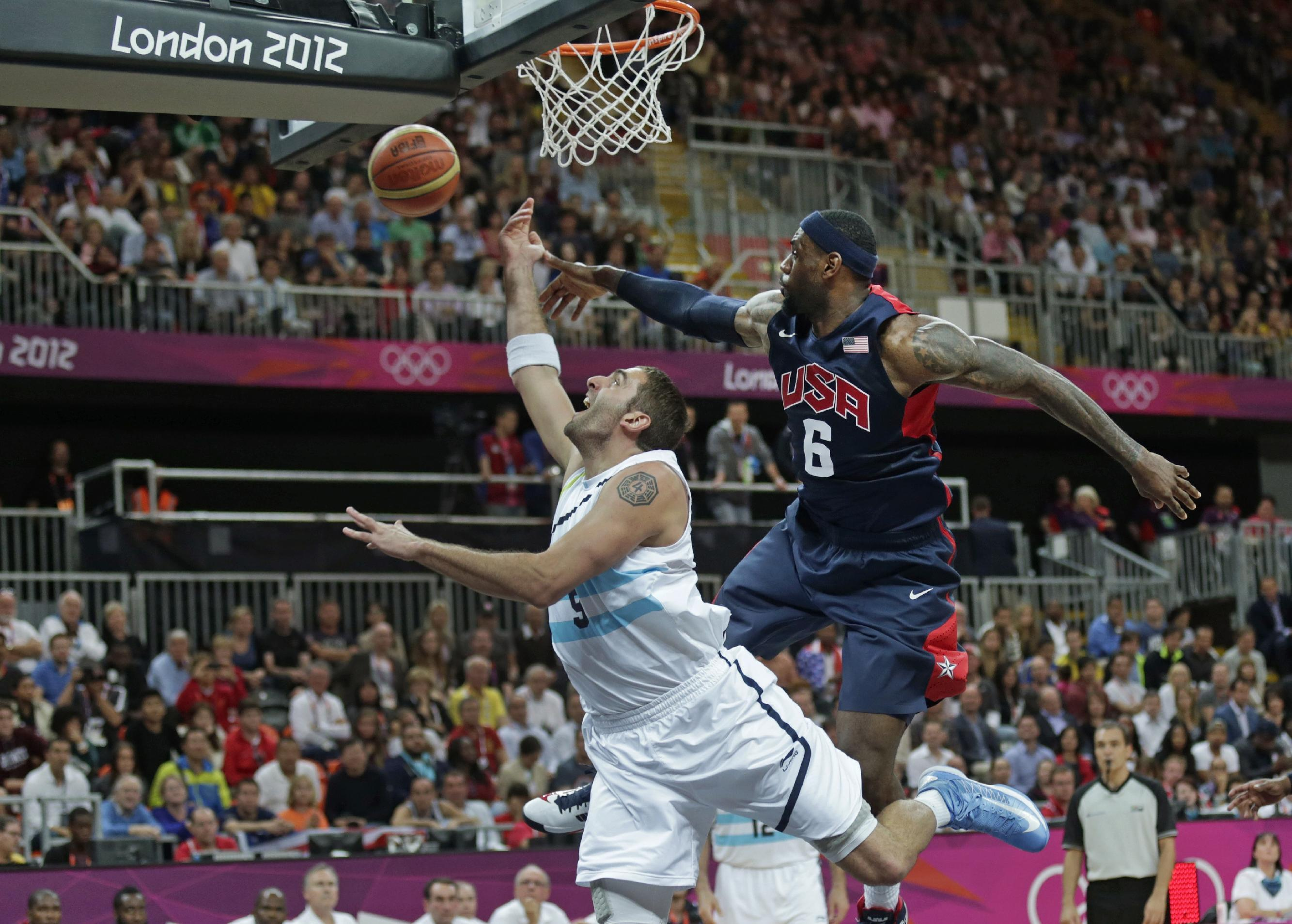 USA's Lebron James (6) fouls Argentina's Juan Gutierrez on a drive to the basket during a men's basketball game at the 2012 Summer Olympics, Monday, Aug. 6, 2012, in London. (AP Photo/Charles Krupa)