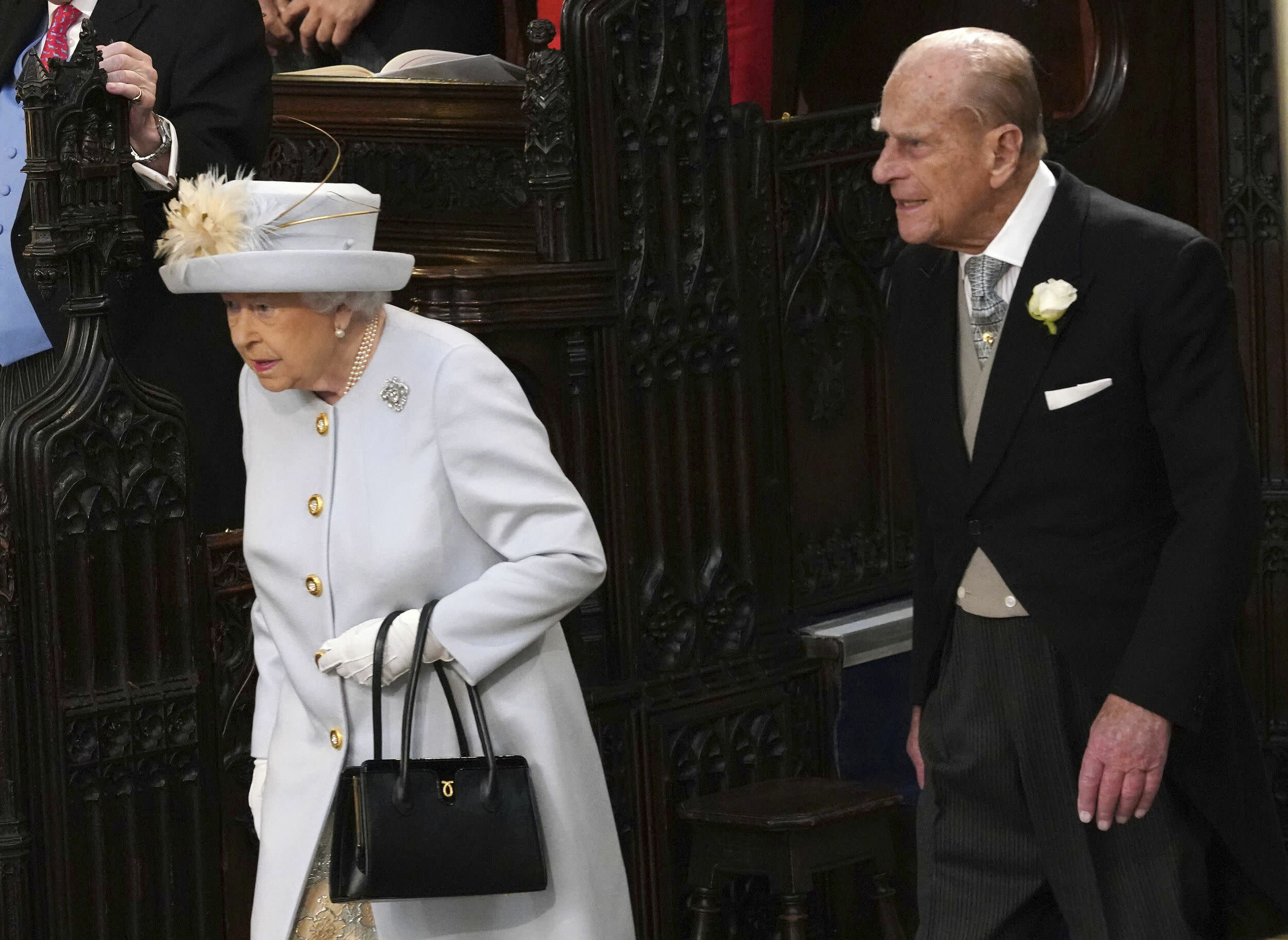 Queen Elizabeth II and Prince Philip arrive for the wedding of Princess Eugenie of York and Jack Brooksbank in St George's Chapel, Windsor Castle, near London, England, Friday Oct. 12, 2018. (Jonathan Brady, Pool via AP)