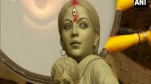 Walking back miles from big city -- Durga finally home with children