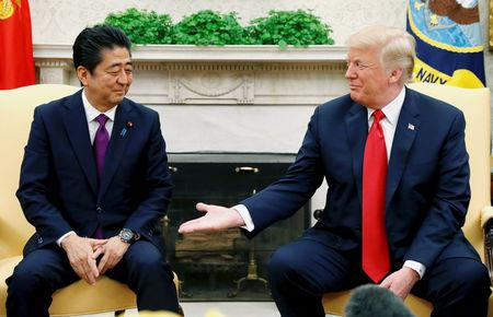 FILE PHOTO: U.S. President Donald Trump meets with Japanese Prime Minister Shinzo Abe in the Oval Office of the White House in Washington, U.S., June 7, 2018. REUTERS/Kevin Lamarque/File Photo