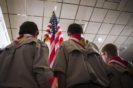 Boy Scouts stand on stage with a U.S. flag during the Pledge of Allegiance to begin the inaugural Freedom Summit meeting for conservative speakers in Manchester