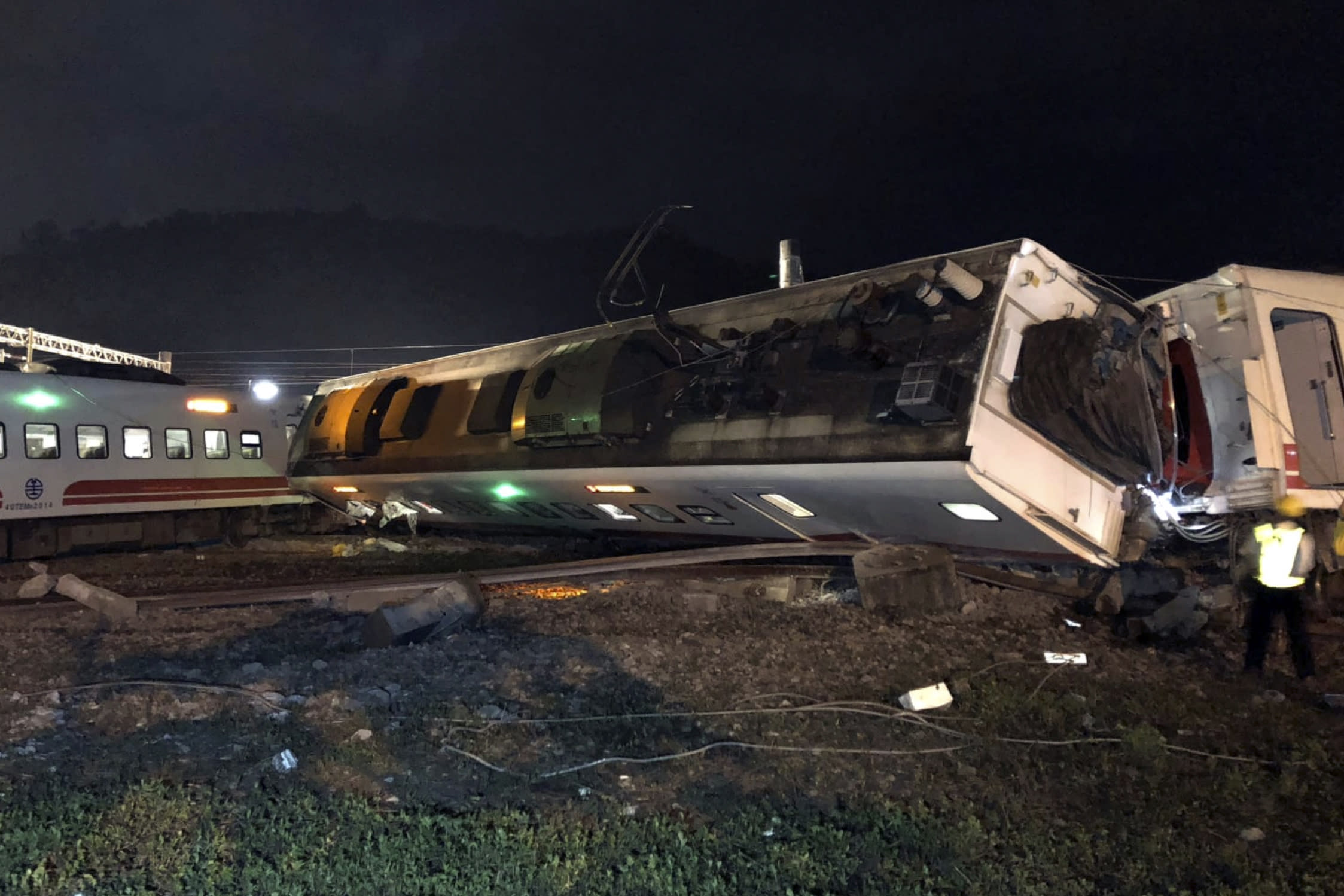 One of Taiwan's fastest trains derails, killing at least 18