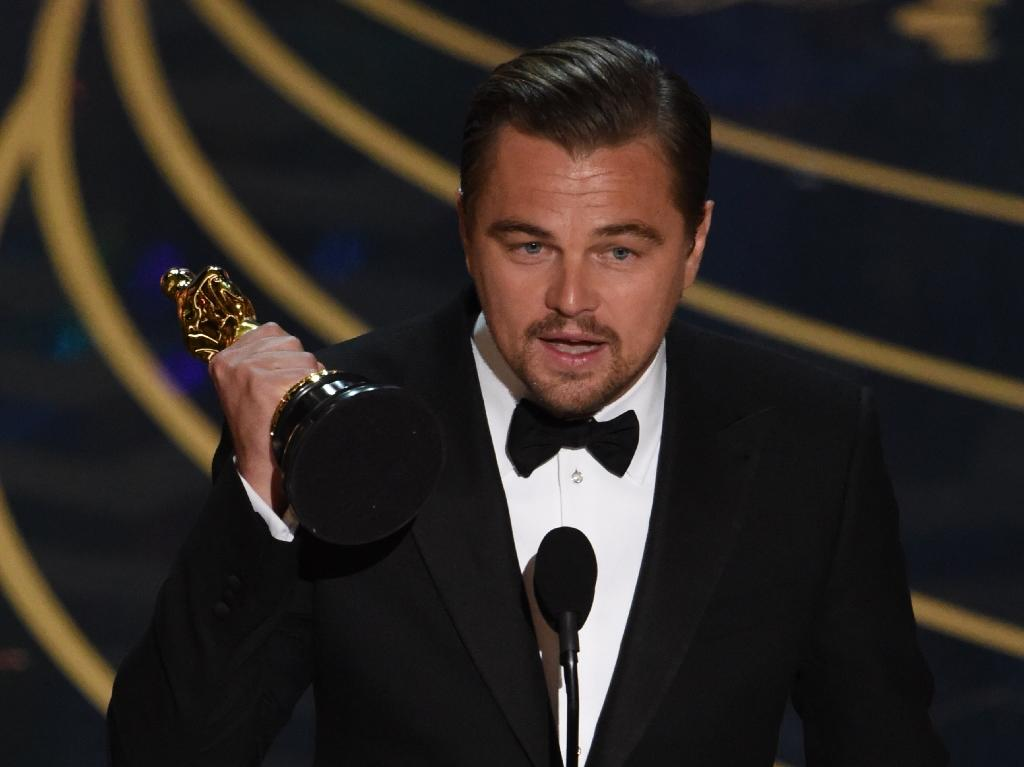 Leonardo DiCaprio accepts the award for Best Actor, in 'The Revenant', during the 88th Oscars, in Hollywood, on February 28, 2016 (AFP Photo/Mark Ralston)