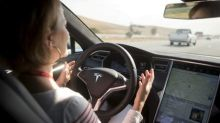 Tesla, others seek ways to ensure drivers keep their hands on the wheel