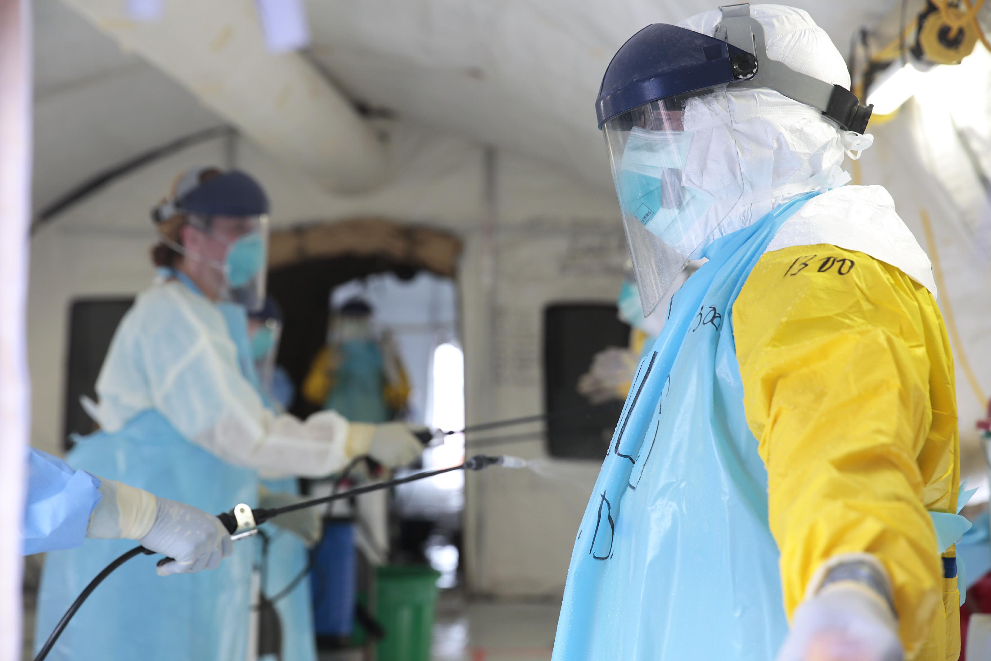 Medical workers treating their protective gear in an Ebola treatment centre in Monrovia, December 19, 2014