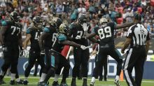 Lewis scores 3 TDs as Jaguars rout Ravens in London