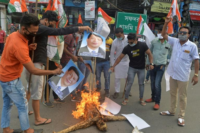 Indian activists burn posters and an effigy of Chinese President Xi Jinping during a June 2020 protest in the eastern city of Siliguri following a deadly border clash (AFP Photo/Diptendu DUTTA)