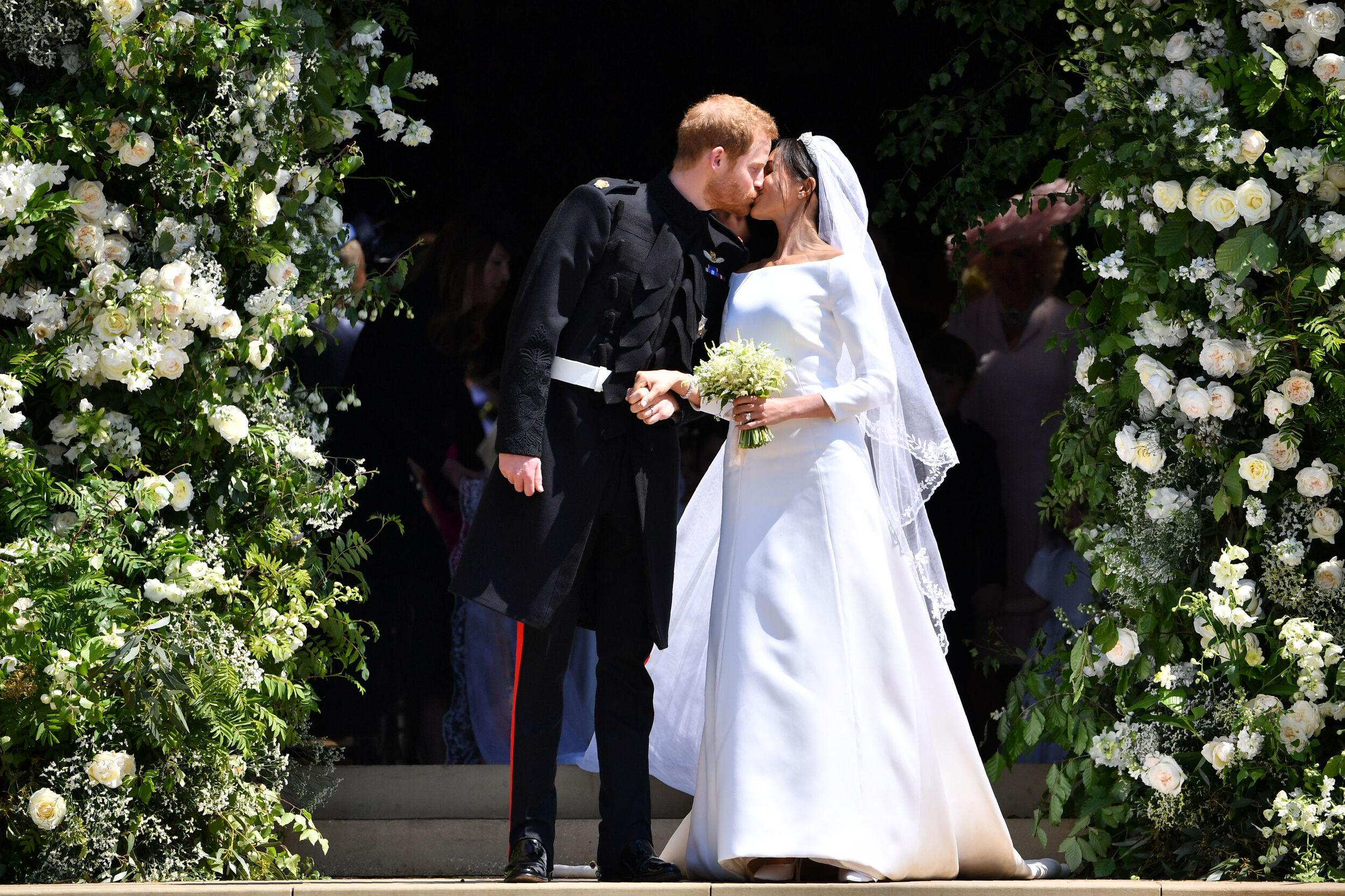 File photo dated 19/05/18 of Prince Harry and Meghan Markle as they leave at St. George's Chapel in Windsor Castle after their wedding ceremony. Princess Eugenie will be the fifth of the Queen's eight grandchildren to wed.