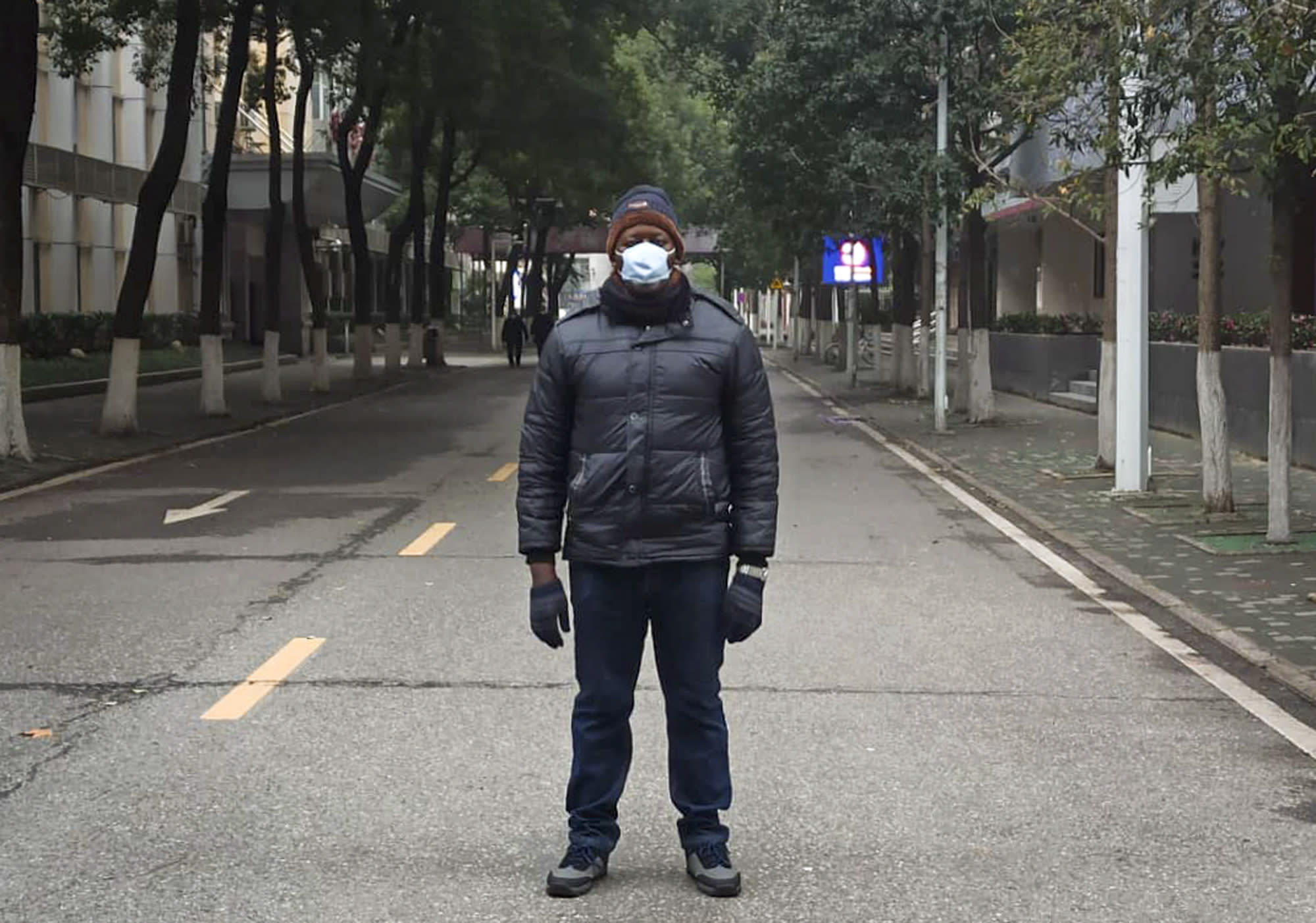 This Jan. 27, 2020, photo, provided by Dr. Khamis Hassan Bakari of Tanzania, shows him posing for a photo in Wuhan, China. Bakari is among more than 4,000 African students in the Chinese city of 11 million people, and has been sending updates on social media about the outbreak of a new virus to the more than 400 other Tanzanian students in Wuhan, as China's astonishing lockdown of more than 30 million people continues. (Khamis Hassan Bakari via AP)