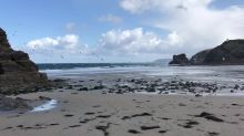 Cornish beach covered in rubbish and fishing nets after stormy night