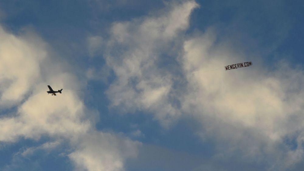 'Wenger In' banner flies over Manchester Derby