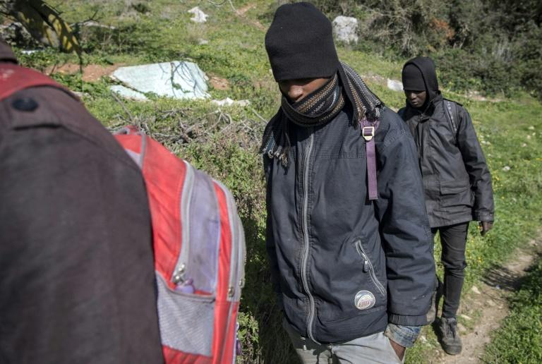 African migrants are pictured in the Belyounech forest, a few kilometres from Ceuta on Morocco's northern coast, in January (AFP Photo/FADEL SENNA)