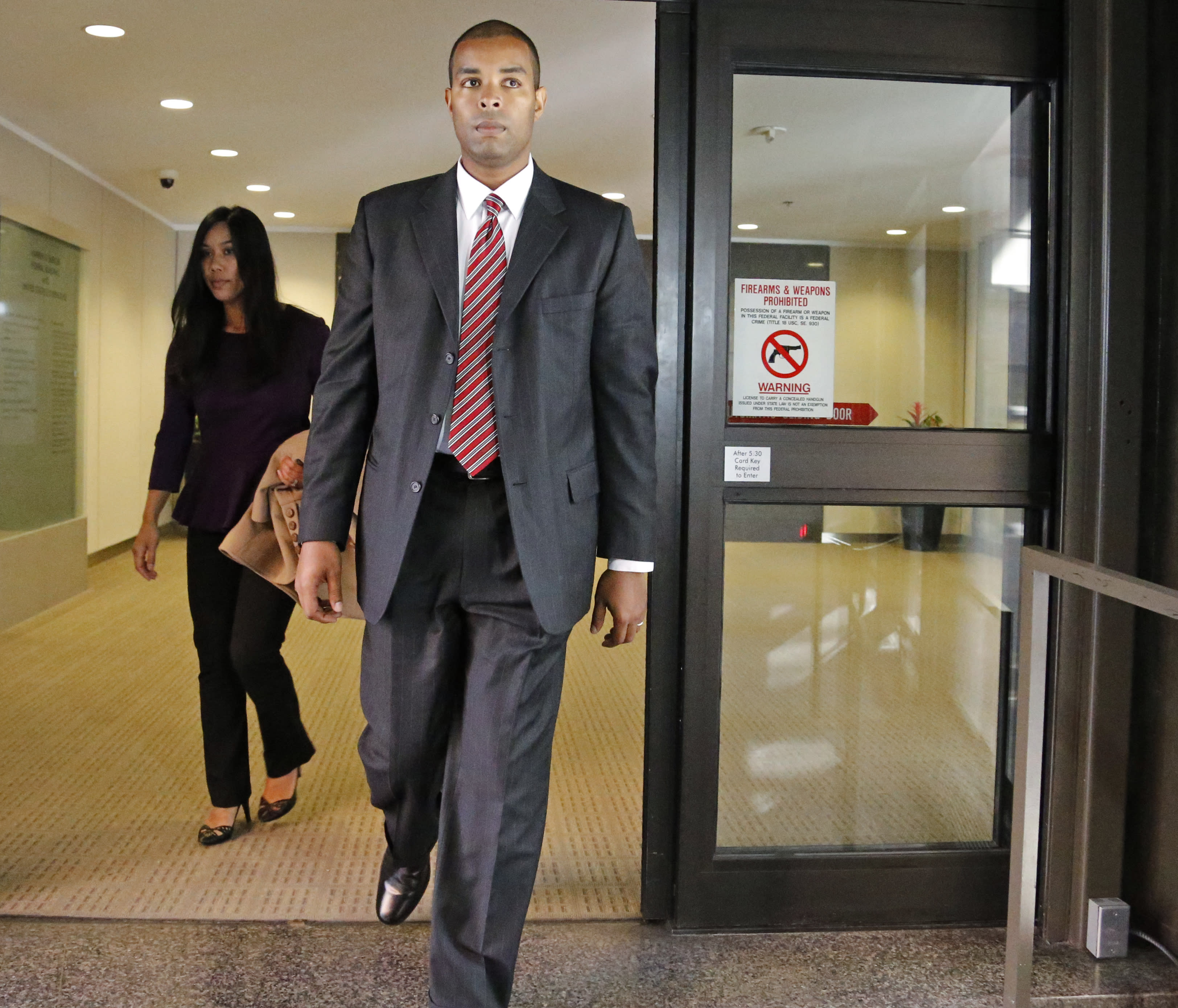 Former Minneapolis FBI agent Terry Albury walks out of the Federal Courthouse in St. Paul Thursday, Oct. 18, 2018 after Albury was sentenced to four years in prison for leaking classified defense documents to a reporter. (Shari L. Gross/Star Tribune via AP)