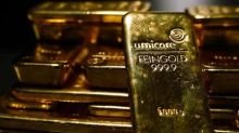 Gold climbs above $1.300 threshold, hits 9-month high