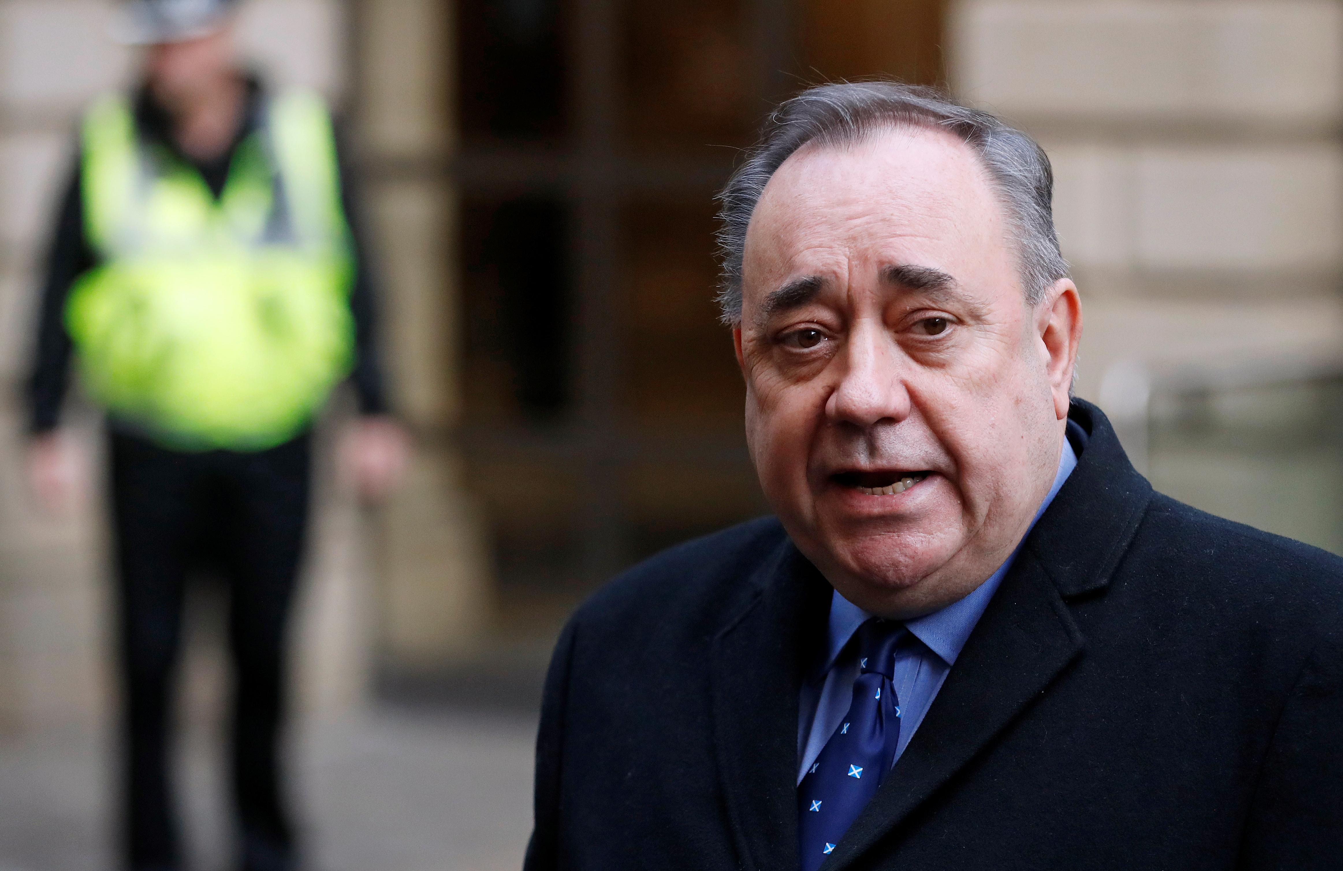 Alex Salmond 'lay on top of woman and tried to rape her', court hears
