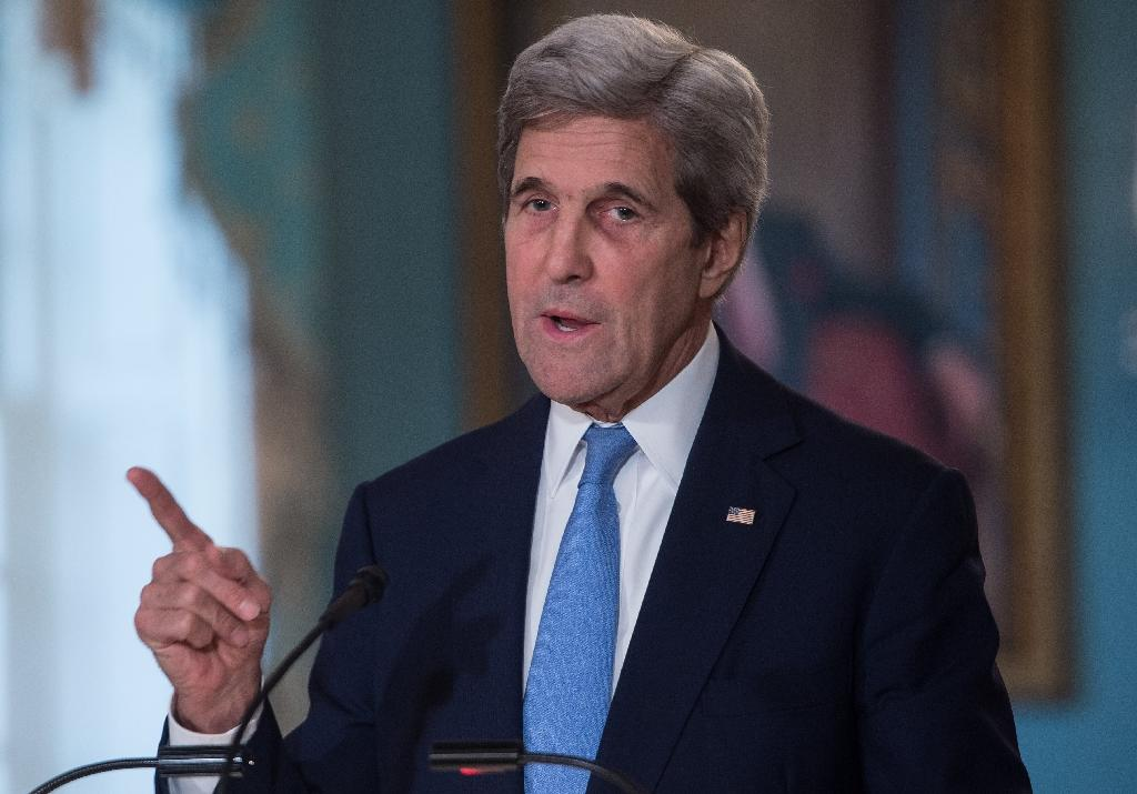 US Secretary of State John Kerry said it would be up to the US Department of Justice and the FBI to respond to further questions about the Clinton email probe
