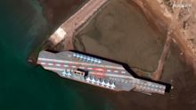 Iran's navy shoots missile at mock-up of US aircraft carrier in the Strait of Hormuz