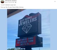 Chick-fil-A and jewelry store have playful 'sign war' and their Alabama town loves it