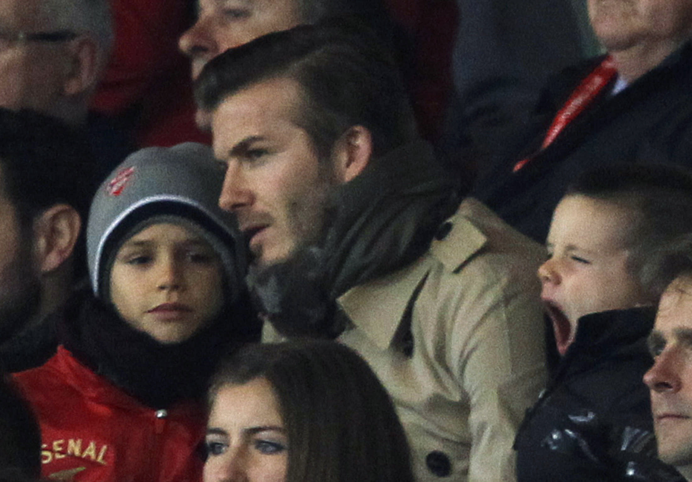 David Beckham and his sons, Brooklyn Joseph (L) and Romeo James, watch the FA Cup soccer match between Arsenal and Leeds United at the Emirates Stadium in London, January 9, 2012. REUTERS/Eddie Keogh (BRITAIN - Tags: SPORT SOCCER)