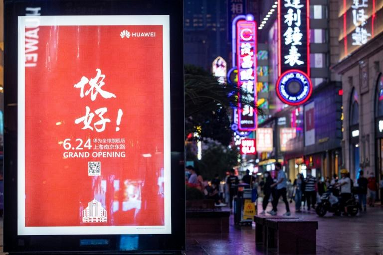 A billboard in Shanghai in June 2020 advertises a global flagship store of Huawei, the Chinese telecom giant which the United States is seeking to counter (AFP Photo/STR)