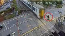 Shocking video captures man's very close call with train