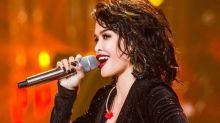 "KZ Tandingan wows audience on ""Singer 2018"""