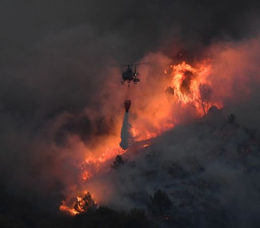 Firefighters battle blazes in France and Portugal