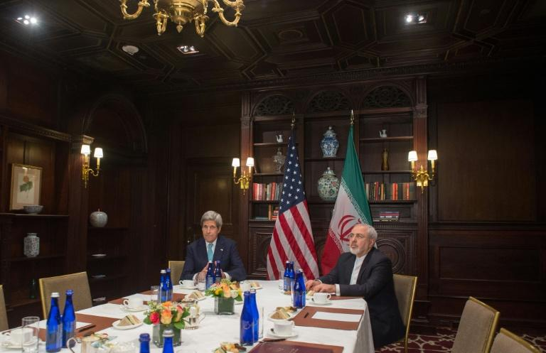 Iranian conservatives resented Zarif's close relationship with his US counterpart, John Kerry (L), during the nuclear talks (AFP Photo/Bryan R. Smith)