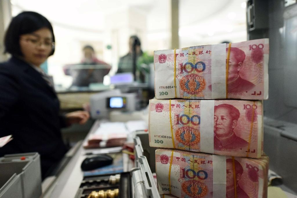 Worries about China's economy have pushed the yuan to a five-year low, with foreign exchange reserves seeing their first-ever annual decline last year as Beijing tried to prevent a more drastic devaluation (AFP Photo/)