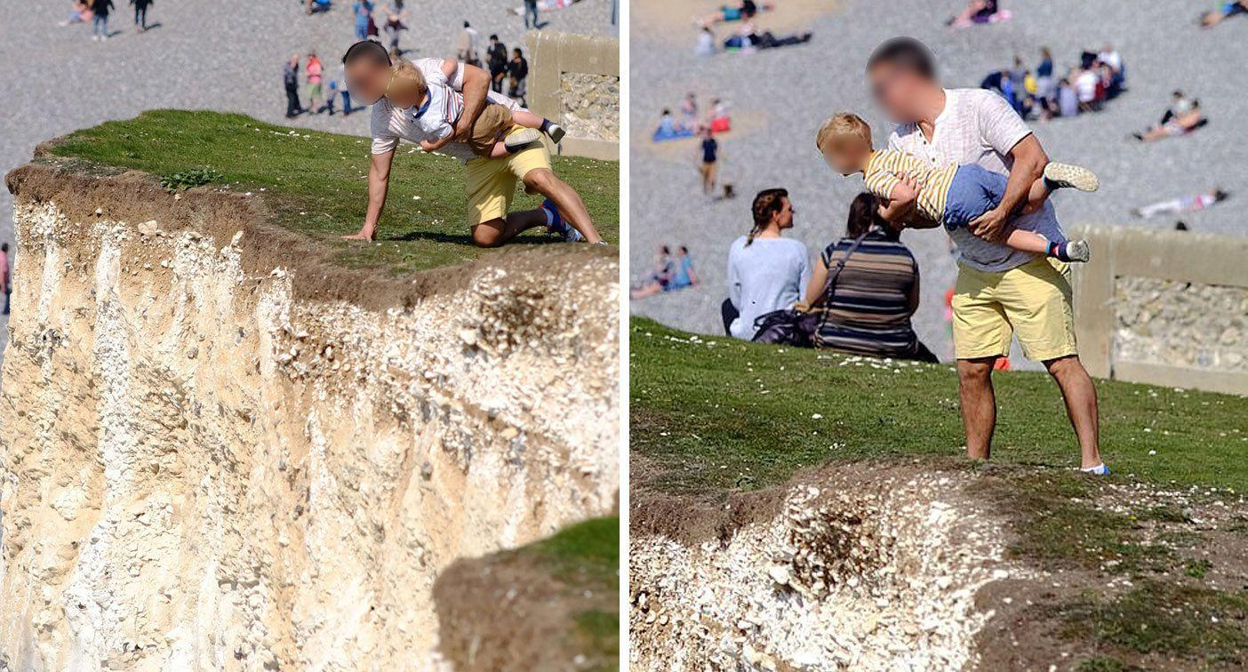 Man carrying toddler stands uncomfortably close to cliff's edge