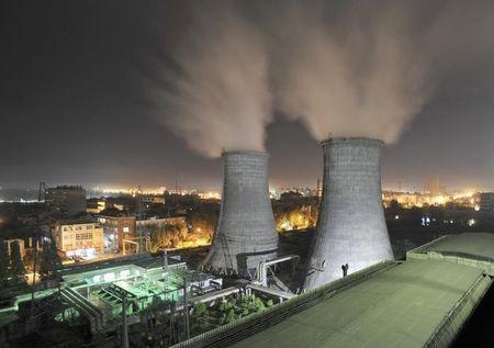 A general view shows a coal-burning power station at night in Xiangfan