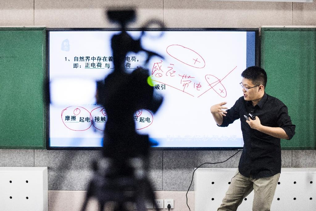 Chinese high school physics tutor Liu Jie gives an online lesson from a recording studio in Beijing (AFP Photo/Fred Dufour)