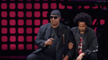 Stevie Wonder takes a knee on stage in protest against Donald Trump's attack on NFL players